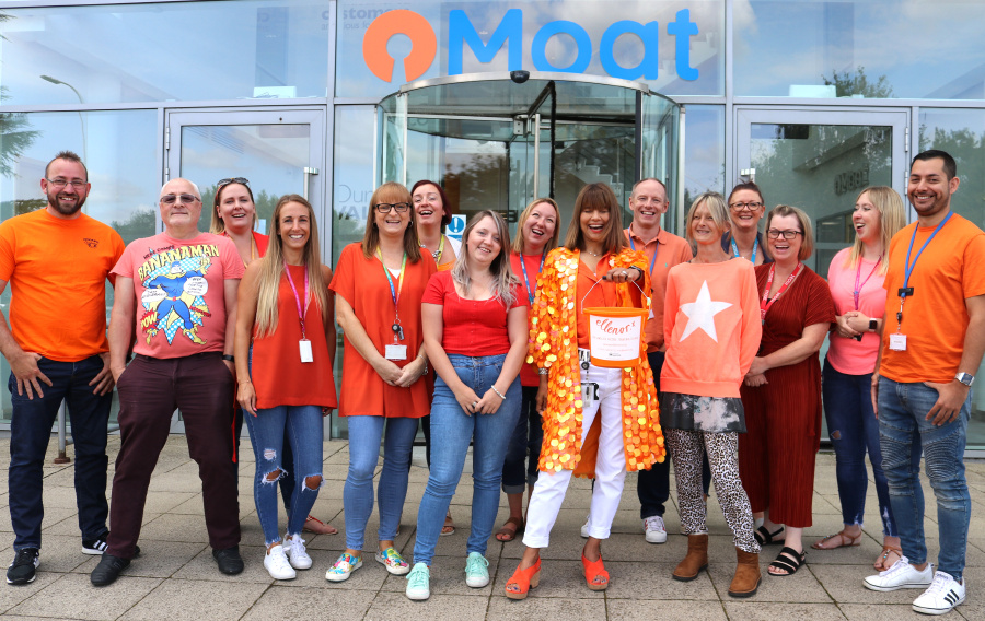 A group of Moat employees dressed in orange for our Charity of the Year