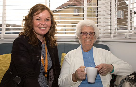 Moat Foundation Officer and a service user having a cup of tea